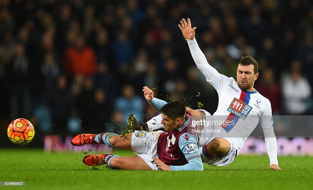 Ashley Westwood of Aston Villa and James McArthur of Crystal Palace battle for the ball during the Barclays Premier League match between Aston Villa and Crystal Palace at Villa Park on January 12, 2016 in Birmingham, England.