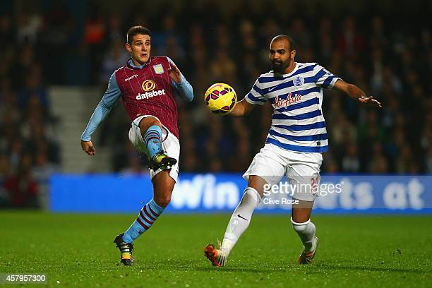 Ashley Westwood of Aston Villa and Sandro of QPR compete for the ball during the Barclays Premier League match between Queens Park Rangers and Aston...