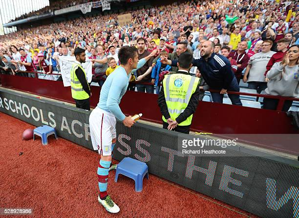 Ashley Westwood of Aston Villa applauds supporters before leaving the pitch after the Barclays Premier League match between Aston Villa and Newcastle...