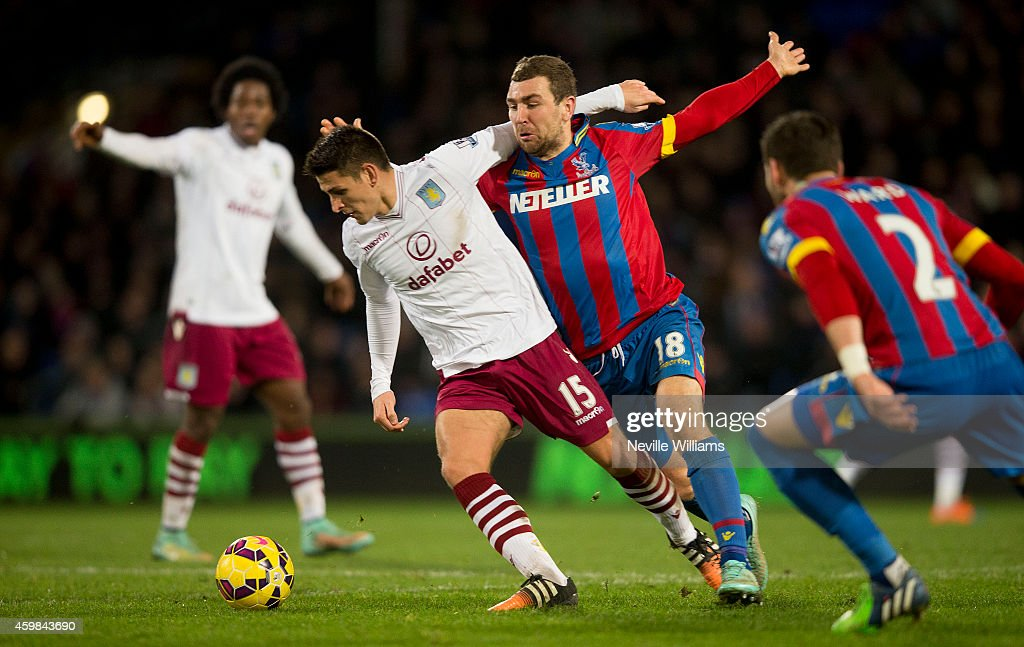 Ashley Westwood of Aston Villa is challenged by James McArthur of Crystal Palace during the Barclays Premier League match between Crystal Palace and Aston Villa at Selhurst Park on December 02, 2014 in London, England.