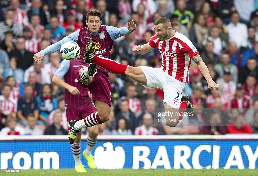 Ashley Westwood (L) of Aston Villa is challenged by Phil Bardsley (R) of Stoke City during the Barclays Premier League match between Stoke City and Aston Villa at the Britannia Stadium on August 16, 2014 in Stoke on Trent, England.