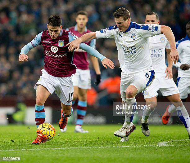 Ashley Westwood of Aston Villa is challenged by Robert Huth of Leicester City during the Barclays Premier League match between Aston Villa and...