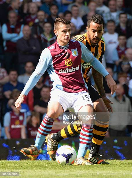 Ashley Westwood of Aston Villa is closed down by Tom Huddlestone of Hull City during the Barclays Premier League match between Aston Villa and Hull...