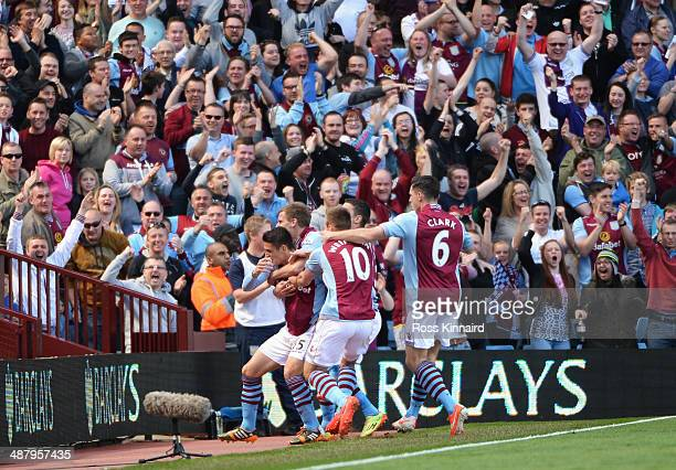 Ashley Westwood of Aston Villa is mobbed by team mates after scoring the opening goal during the Barclays Premier League match between Aston Villa...
