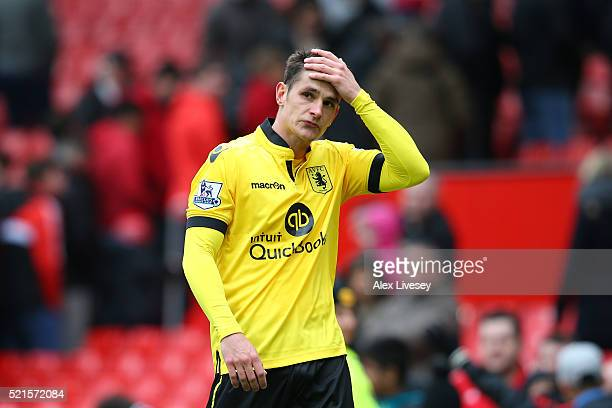 Ashley Westwood of Aston Villa looks dejected after his team were relegated during the Barclays Premier League match between Manchester United and...