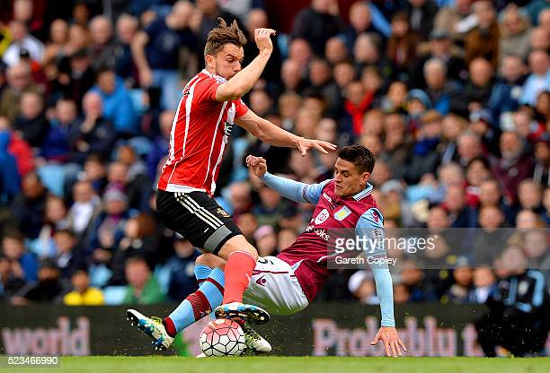 Ashley Westwood of Aston Villa makes a tackle on Jay Rodriguez of Southampton during the Barclays Premier League match between Aston Villa and...