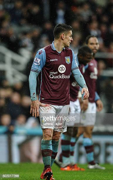 Ashley Westwood of Aston Villa walks off the pitch with a blood soaked strip during the Barclays Premier League match between Newcastle United and...