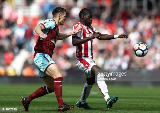 Ashley Westwood of Burnley and Badou Ndiaye of Stoke City battle for the ball during the Premier League match between Stoke City and Burnley at...