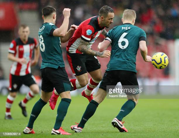 Ashley Westwood of Burnley and Ben Mee of Burnley battles for possession with Danny Ings of Southampton during the Premier League match between...