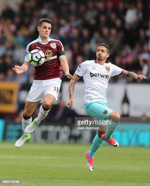 Ashley Westwood of Burnley and Manuel Lanzini of West Ham United battle for possession during the Premier League match between Burnley and West Ham...