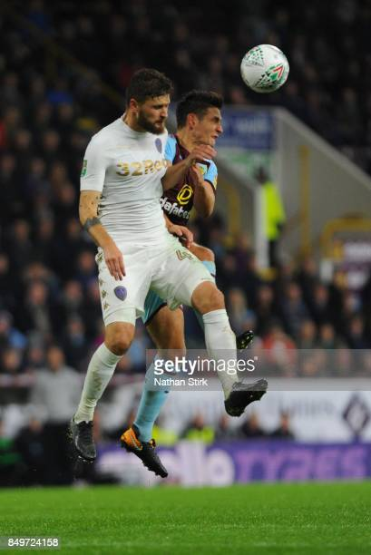 Ashley Westwood of Burnley and Mateusz Klich of Leeds in action during the Carabao Cup Third Round match between Burnley and Leeds United at Turf...
