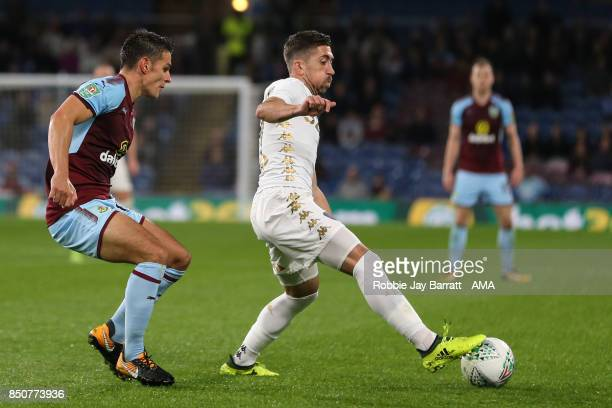 Ashley Westwood of Burnley and Pablo Hernandez of Leeds United during the Carabao Cup Third Round match between Burnley and Leeds United at Turf Moor...