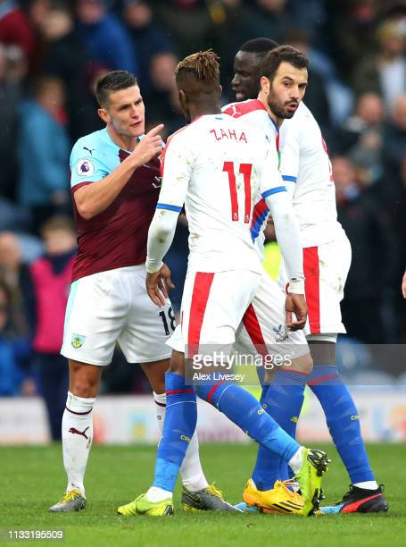 Ashley Westwood of Burnley argues with Wilfried Zaha of Crystal Palace as they walk off at half time during the Premier League match between Burnley...