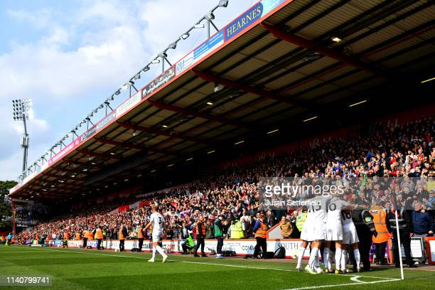 Ashley Westwood of Burnley celebrates after scoring his team's second goal with team mates and fans 1during the Premier League match between AFC...