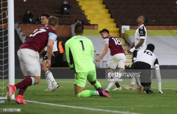 Ashley Westwood of Burnley celebrates after scoring their team's first goal during the Premier League match between Fulham and Burnley at Craven...