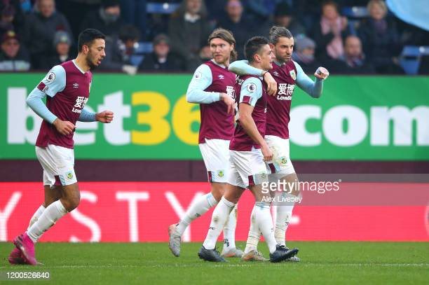 Ashley Westwood of Burnley celebrates with Jay Rodriguez and Jeff Hendrick after scoring his team's second goal during the Premier League match...
