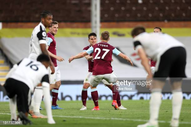Ashley Westwood of Burnley celebrates with Matej Vydra after scoring their team's first goal during the Premier League match between Fulham and...