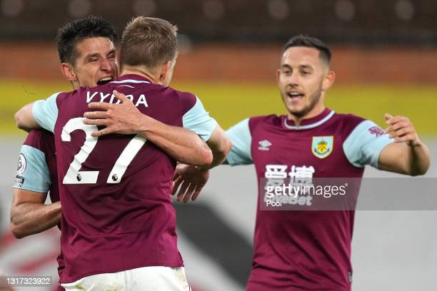 Ashley Westwood of Burnley celebrates with Matej Vydra and Josh Brownhill after scoring their team's first goal during the Premier League match...
