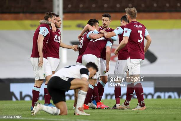 Ashley Westwood of Burnley celebrates with Matej Vydra and teammates after scoring their team's first goal during the Premier League match between...