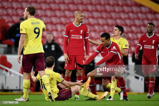 Ashley Westwood of Burnley clashes with Fabinho of Liverpool as Ashley Barnes of Burnley and Joel Matip of Liverpool react during the Premier League...