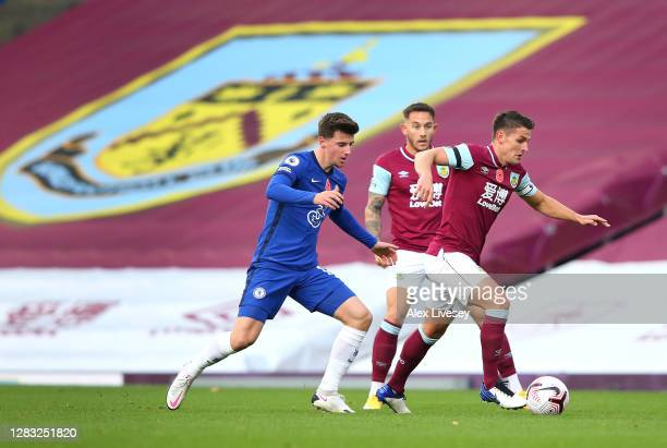 Ashley Westwood of Burnley holds off Mason Mount of Chelsea during the Premier League match between Burnley and Chelsea at Turf Moor on October 31...
