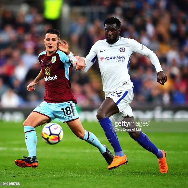 Ashley Westwood of Burnley in action with Tiemoue Bakayoko of Chelsea during the Premier League match between Burnley and Chelsea at Turf Moor on...