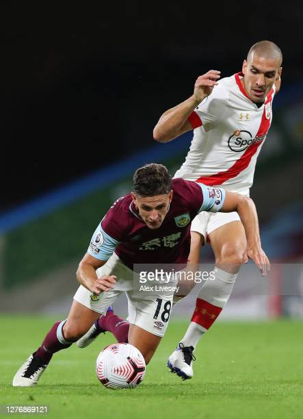Ashley Westwood of Burnley is tackled by Oriol Romeu of Southampton during the Premier League match between Burnley and Southampton at Turf Moor on...