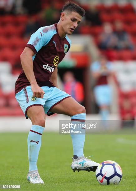 Ashley Westwood of Burnley passes the ball during the pre season friendly match between Kidderminster Harriers and Burnley at Aggborough Stadium on...