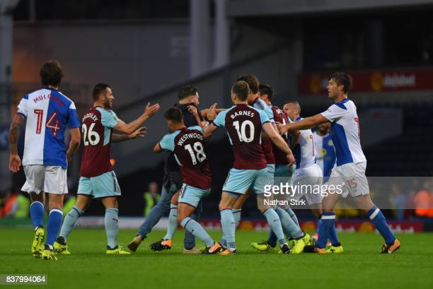 Ashley Westwood of Burnley takes a Blackburn fan down during the Carabao Cup Second Round match between Blackburn Rovers and Burnley at Ewood Park on...