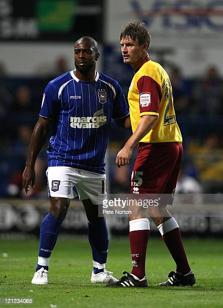 Ashley Westwood of Northampton Town with Nathan Ellington of Ipswich Town during the Carling Cup First Round Match between Ipswich Town and...