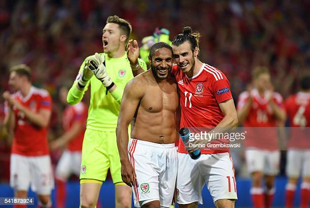 Ashley Williams and Gareth Bale of Wales celebrate their team's 30 win in the UEFA EURO 2016 Group B match between Russia and Wales at Stadium...