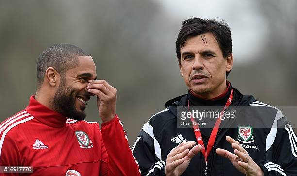 Ashley Williams captain of Wales shares a joke with Wales head coach Chris Coleman before Wales training at the Vale on March 22 2016 in Cardiff...