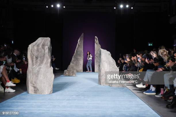 Ashley Williams greets her audience following the runway at the Ashley Williams show during London Fashion Week February 2018 at University of...
