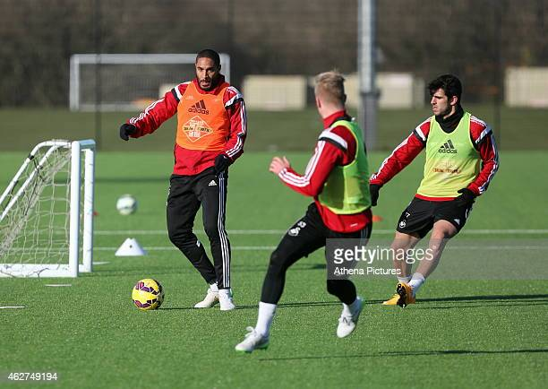Ashley Williams marked by Jordi Amat during a Swansea City training session at Fairwood training ground on February 4 2015 in Swansea Wales