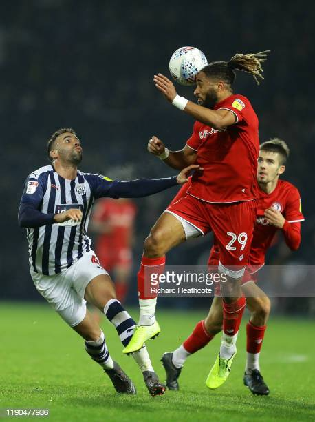 Ashley Williams of Bristol City heads away from Hal RobsonKanu of West Bromwich Albion during the Sky Bet Championship match between West Bromwich...