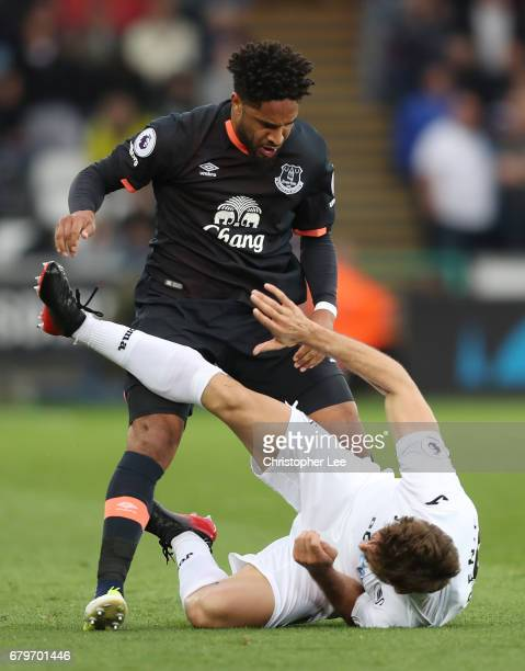 Ashley Williams of Everton and Fernando Llorente of Swansea City tangle during the Premier League match between Swansea City and Everton at the...