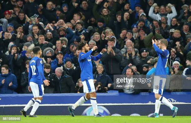 Ashley Williams of Everton celebrates after scoring his sides fourth goal with Gylfi Sigurdsson of Everton during the Premier League match between...