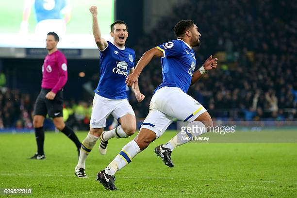 Ashley Williams of Everton celebrates with teammate Leighton Baines of Everton after scoring his team's second goal during the Premier League match...