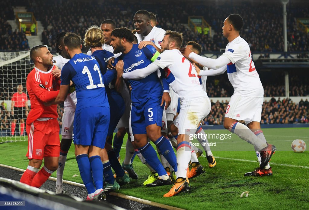 Ashley Williams of Everton (5) clashes with Lyon players after a challenge on Anthony Lopes of Lyon during the UEFA Europa League Group E match between Everton FC and Olympique Lyon at Goodison Park on October 19, 2017 in Liverpool, United Kingdom.