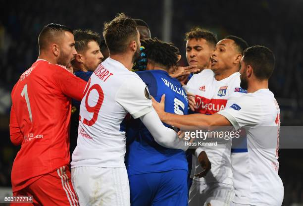 Ashley Williams of Everton clashes with Lyon players during the UEFA Europa League Group E match between Everton FC and Olympique Lyon at Goodison...