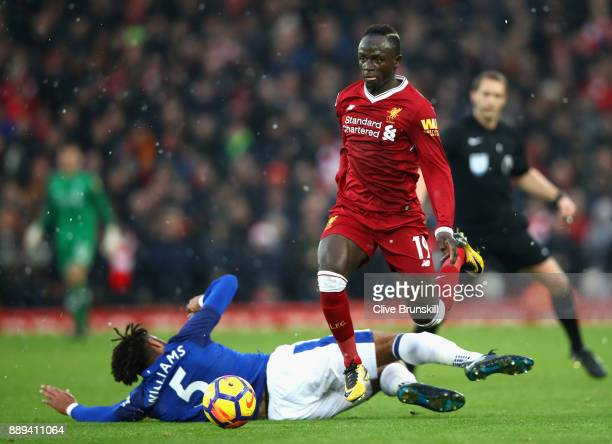 Ashley Williams of Everton goes down whilst tackling Sadio Mane of Liverpool during the Premier League match between Liverpool and Everton at Anfield...