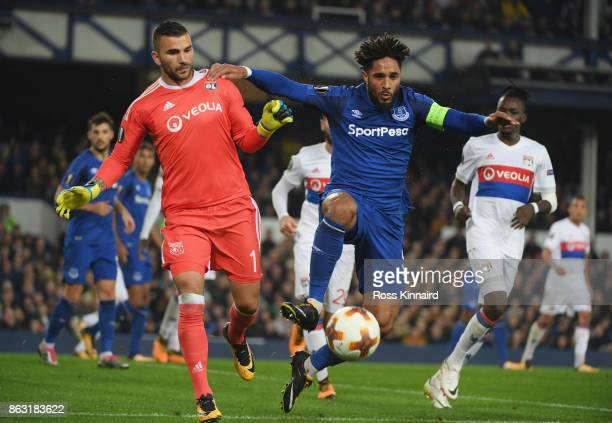 Ashley Williams of Everton holds off goalkeeper Anthony Lopes of Lyon during the UEFA Europa League Group E match between Everton FC and Olympique...