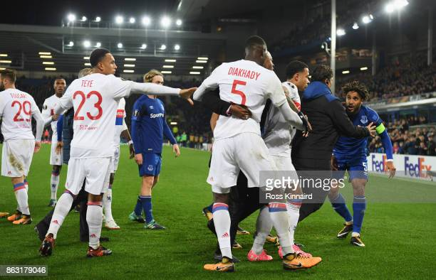 Ashley Williams of Everton is restrained as he clashes with Lyon players after a challenge on Anthony Lopes of Lyon during the UEFA Europa League...