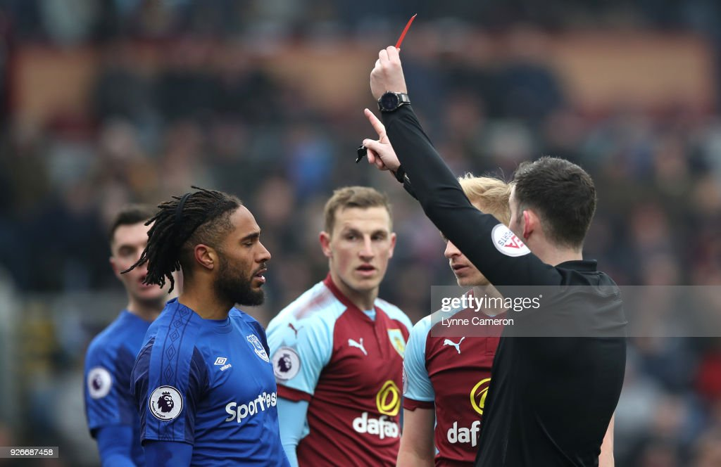Ashley Williams of Everton is shown a red card by referee Chris Kavanagh during the Premier League match between Burnley and Everton at Turf Moor on March 3, 2018 in Burnley, England.