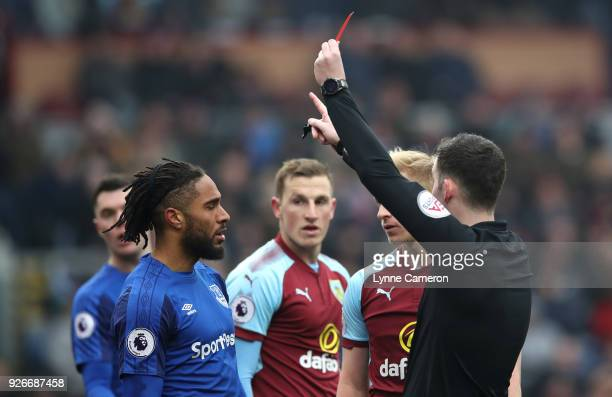 Ashley Williams of Everton is shown a red card by referee Chris Kavanagh during the Premier League match between Burnley and Everton at Turf Moor on...