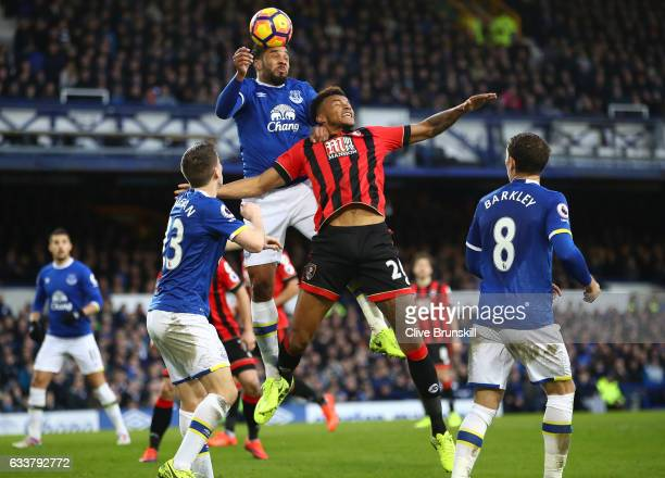 Ashley Williams of Everton wins a header over Tyrone Mings of AFC Bournemouth during the Premier League match between Everton and AFC Bournemouth at...