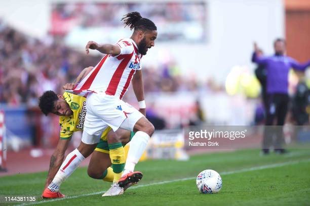 Ashley Williams of Stoke City and Maximillian Aarons of Norwich City in action during the Sky Bet Championship match between Stoke City and Norwich...