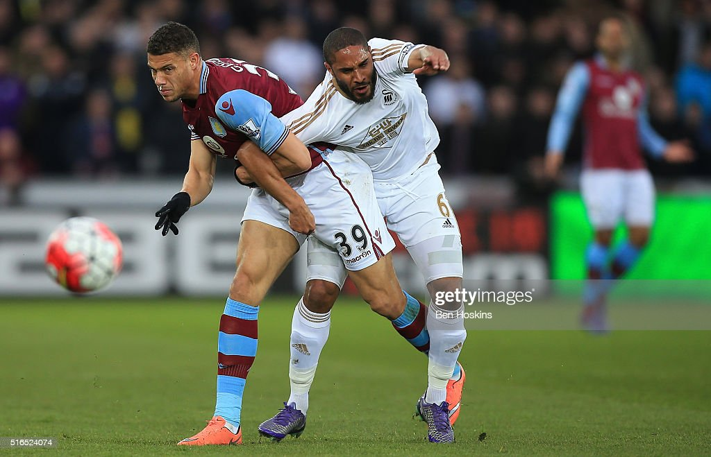 Ashley Williams of Swansea City and Rudy Gestede of Aston Villa compete for the ball during the Barclays Premier League match between Swansea City and Aston Villa at Liberty Stadium on March 19, 2016 in Swansea, United Kingdom.