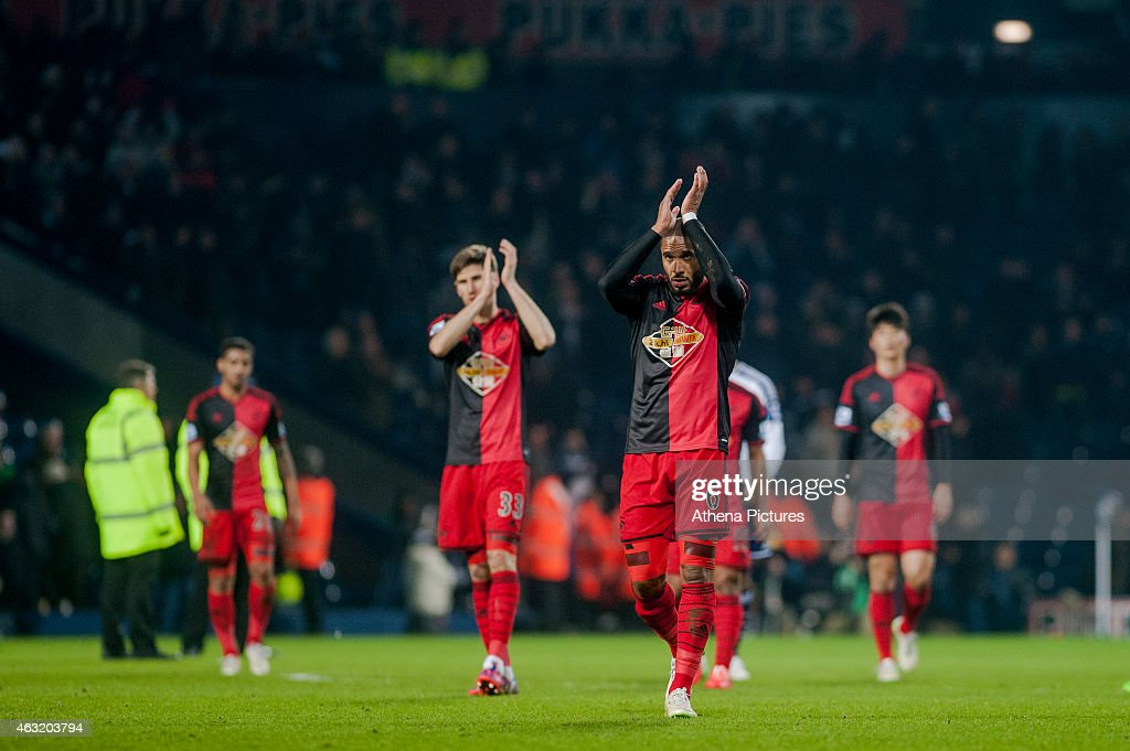 Ashley Williams of Swansea City applauds the Swansea City fans after the final whistle at the Premier League match between West Bromwich Albion and Swansea City at The Hawthorns on February 11, 2015 in West Bromwich, England.