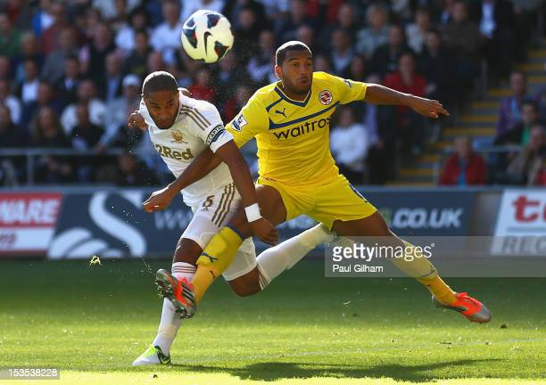 Ashley Williams of Swansea City battles for the ball with Adrian Mariappa of Reading during the Barclays Premier League match between Swansea City...